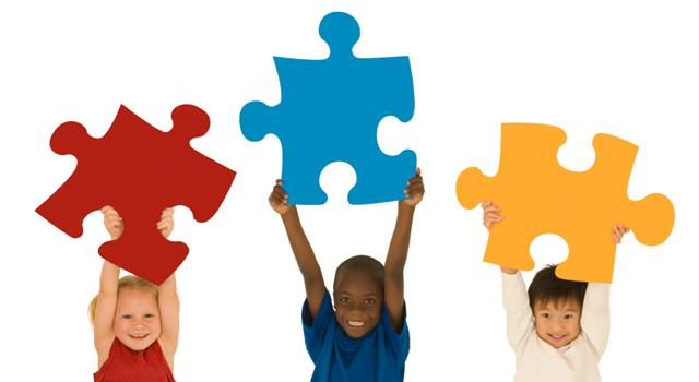 Children Holding Up Puzzles for Autism