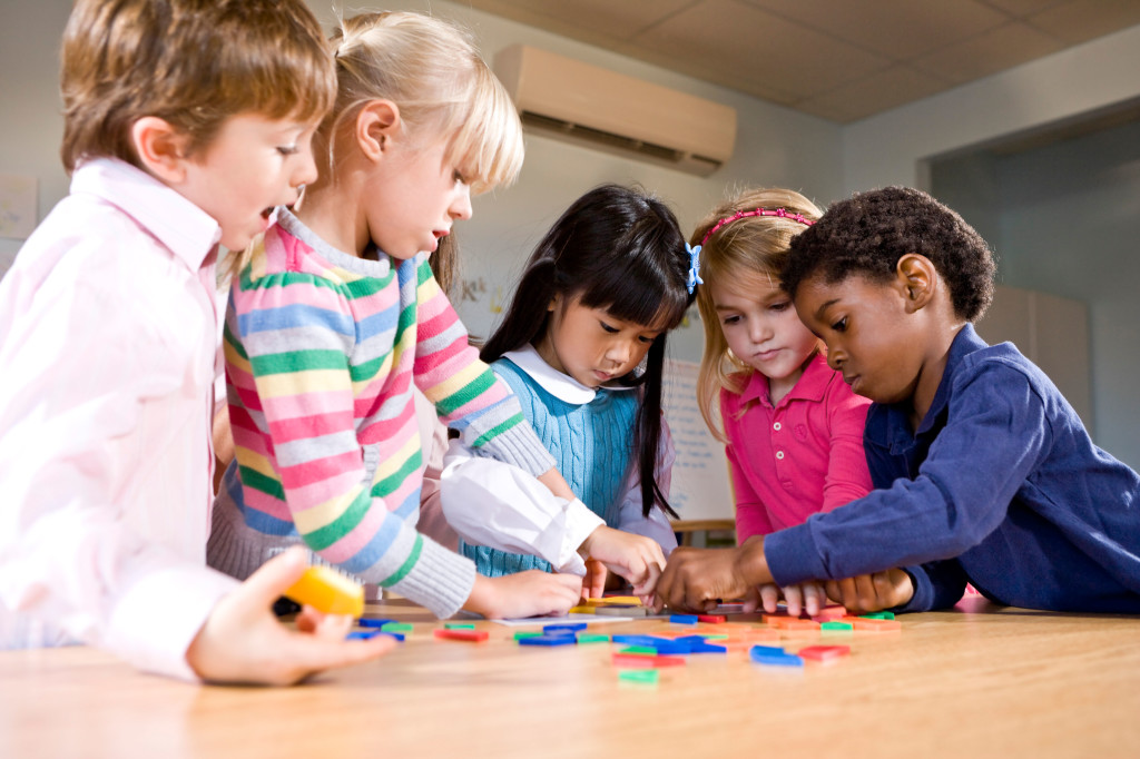 Preschool children working together on puzzle. Image shot 2009. Exact date unknown.